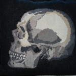 Cross-stiched skull pillows